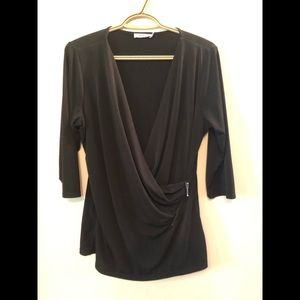 Black wrap top with zipper accent